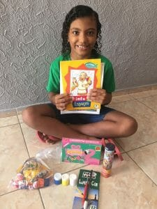 Young girl loving books is returning to school